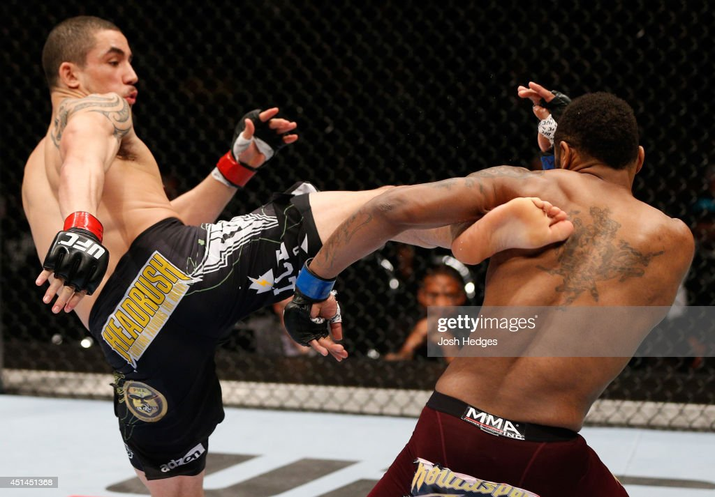 Robert Whittaker kicks Mike Rhodes in their welterweight fight during the UFC Fight Night event at Vector Arena on June 28, 2014 in Auckland, New Zealand.