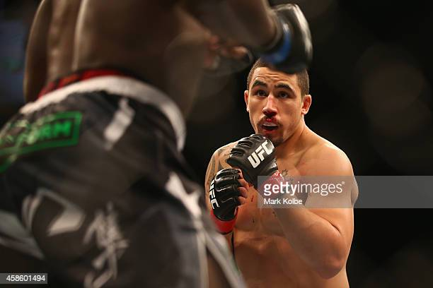 Robert Whittaker of Australia shapes up to Clint Hester in their middleweight fight during the UFC Fight Night 55 event at Allphones Arena on...