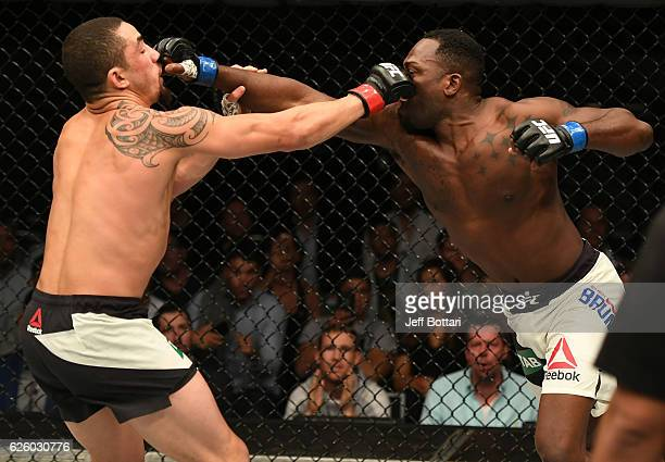 Robert Whittaker of New Zealand and Derek Brunson trade punches in their middleweight bout during the UFC Fight Night event at Rod Laver Arena on...