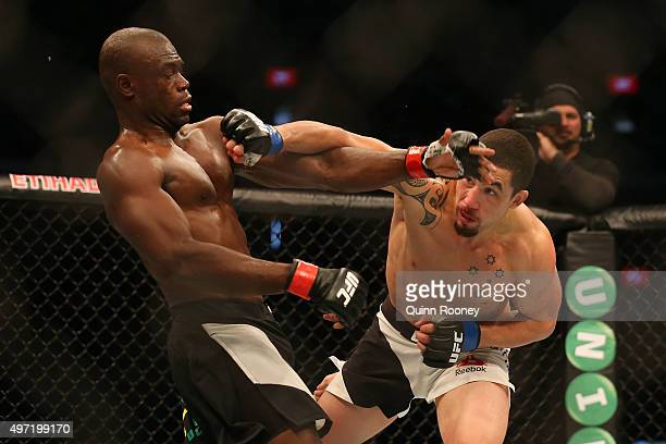 Robert Whittaker of New Zealand and Uriah Hall of Jamaica compete in their middleweight bout during the UFC 193 event at Etihad Stadium on November...
