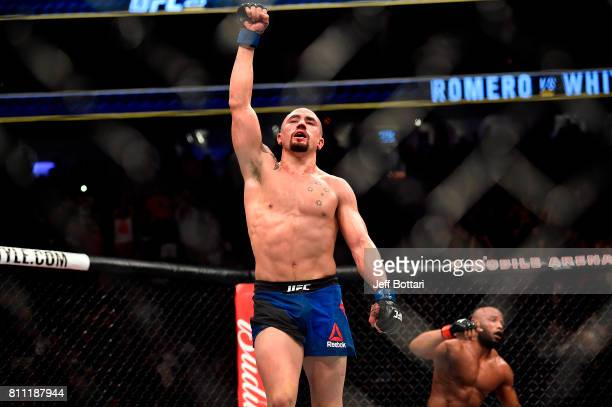 Robert Whittaker of New Zealand celebrates after finishing five rounds against Yoel Romero of Cuba in their interim UFC middleweight championship...