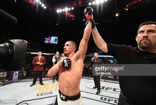 Robert Whittaker of New Zealand celebrates his victory over Rafael Natal after their middleweight bout during the UFC 197 event inside MGM Grand...