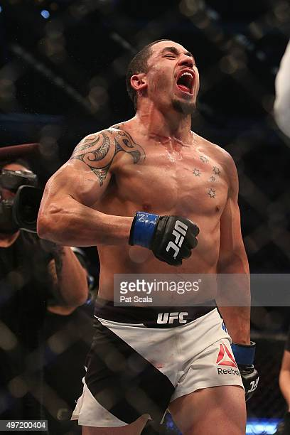 Robert Whittaker of New Zealand celebrates victory over Uriah Hall of Jamaica in their middleweight bout during the UFC 193 event at Etihad Stadium...