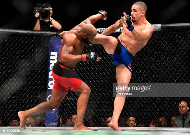 Robert Whittaker of New Zealand kicks Yoel Romero of Cuba in their interim UFC middleweight championship bout during the UFC 213 event at the TMobile...