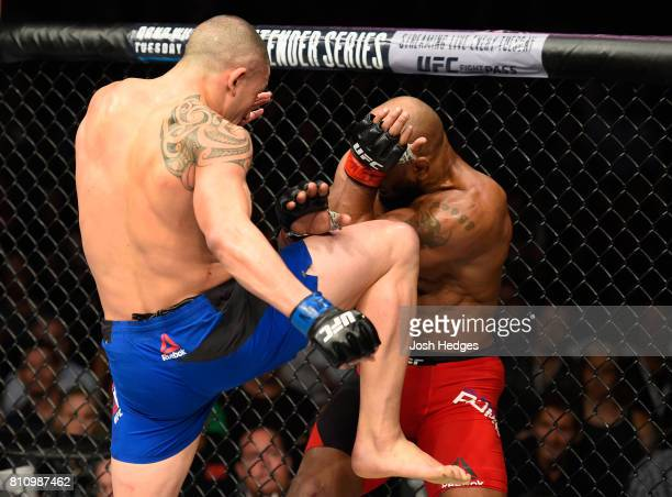 Robert Whittaker of New Zealand knees Yoel Romero of Cuba in their interim UFC middleweight championship bout during the UFC 213 event at TMobile...