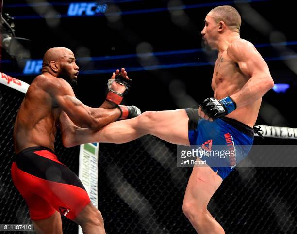 Robert Whittaker of New Zealand lands a front kick to the body of Yoel Romero of Cuba in their interim UFC middleweight championship bout during the...