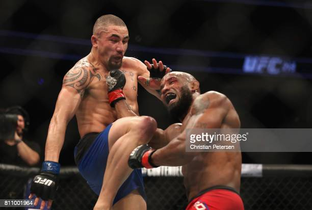 Robert Whittaker of New Zealand lands a knee against Yoel Romero of Cuba in their interim UFC middleweight championship bout during the UFC 213 event...