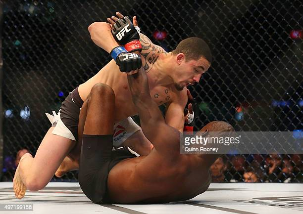 Robert Whittaker of New Zealand pins down Uriah Hall of Jamaica in their middleweight bout during the UFC 193 event at Etihad Stadium on November 15...