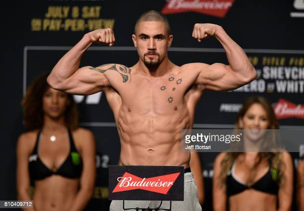 Robert Whittaker of New Zealand poses on the scale during the UFC 213 weighin at the Park Theater on July 7 2017 in Las Vegas Nevada