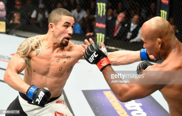 Robert Whittaker of New Zealand punches Jacare Souza of Brazil in their middleweight fight during the UFC Fight Night event at Sprint Center on April...