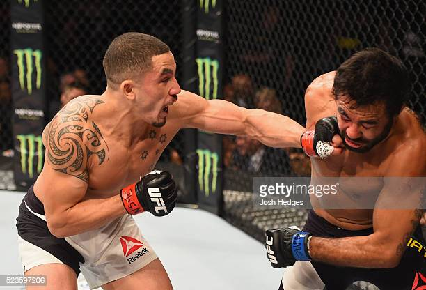 Robert Whittaker of New Zealand punches Rafael Natal in their middleweight bout during the UFC 197 event inside MGM Grand Garden Arena on April 23...