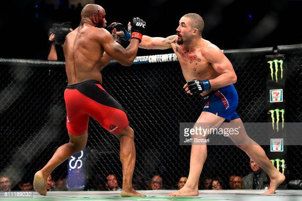 Robert Whittaker of New Zealand punches Yoel Romero of Cuba in their interim UFC middleweight championship bout during the UFC 213 event at the...