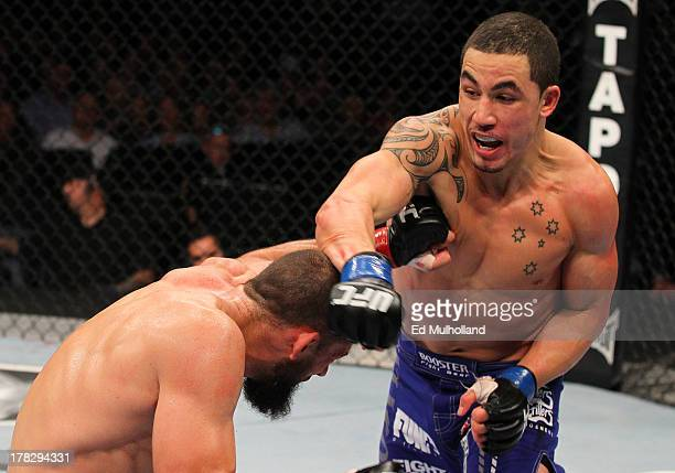 Robert Whittaker punches Court McGee in their welterweight fight during the UFC on FOX Sports 1 event at Bankers Life Fieldhouse on August 28 2013 in...