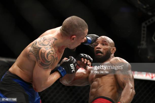 Robert Whittaker punches Yoel Romero in their interim UFC middleweight championship bout during the UFC 213 event at TMobile Arena on July 9 2017 in...