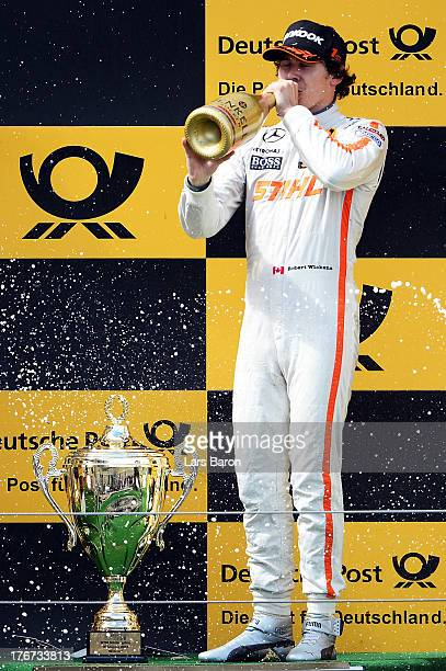 Robert Wickens of Canada and STIHL Mercedes AMG celebrates after winning the seventh round of the DTM 2013 German Touring Car Championship at...