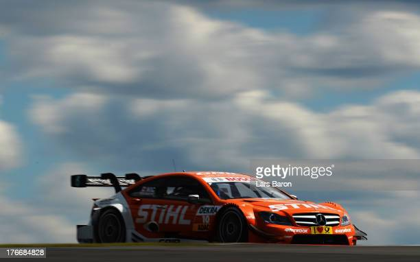 Robert Wickens of Canada and STIHL Mercedes AMG drives during the qualifying for the seventh round of the DTM 2013 German Touring Car Championship at...