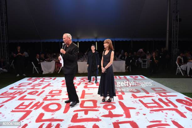 Robert WIlson Laurie Anderson and Isabelle Huppert attend The 24th Annual Watermill Center Summer Benefit Auction at The Watermill Center on July 29...