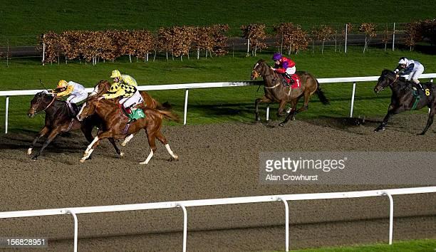 Robert Winston riding Jack Of Diamonds win The 32Red Casino Handicap Stakes at Kempton racecourse on November 22 2012 in Sunbury England