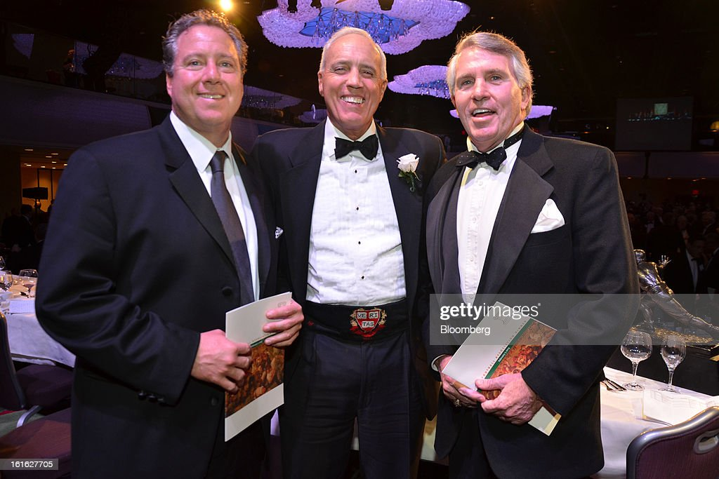 Robert Wolf, founder of 32 Advisors LLC, from left, Jerry Jordan of the Hellman Jordan Management Company, and Jack Ford, a lawyer and CBS News legal analyst, attend the Ivy Football Association Dinner at the Marriott Marquis in New York, U.S. on Thursday, Feb. 7, 2013. The event brought together alumni who played football for the eight schools in the Ivy League: Brown, Columbia, Cornell, Dartmouth, Harvard, University of Pennsylvania, Princeton and Yale. Photographer: Amanda Gordon/Bloomberg via Getty Images