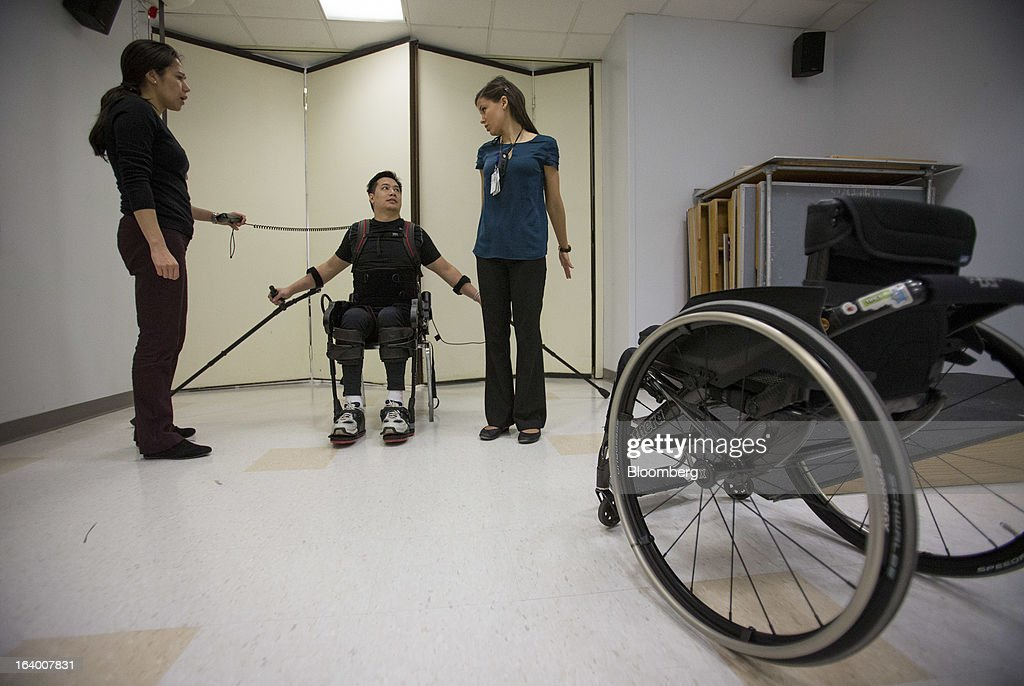 Robert Woo, 45, discusses his therapy while sitting on a chair in an Ekso Bionics 'exoskeleton,' at Mount Sinai Medical Center in New York, U.S., on Thursday, March 14, 2013. Wearable machines that enhance human muscle power are poised to leave the realm of science fiction and help factory workers hoist heavier tools, lighten soldiers' loads and enable spinal patients to walk. Photographer: Scott Eells/Bloomberg via Getty Images