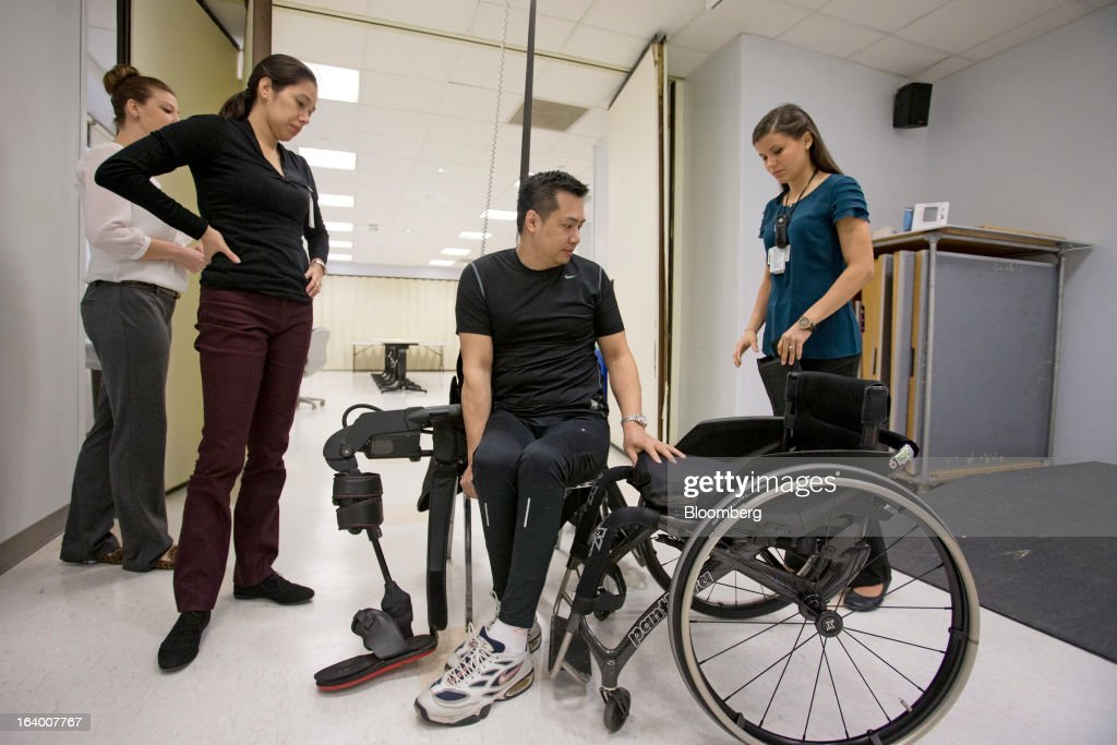 Robert Woo, 45, prepares to get into an Ekso Bionics 'exoskeleton,' at Mount Sinai Medical Center in New York, U.S., on Thursday, March 14, 2013. Wearable machines that enhance human muscle power are poised to leave the realm of science fiction and help factory workers hoist heavier tools, lighten soldiers' loads and enable spinal patients to walk. Photographer: Scott Eells/Bloomberg via Getty Images