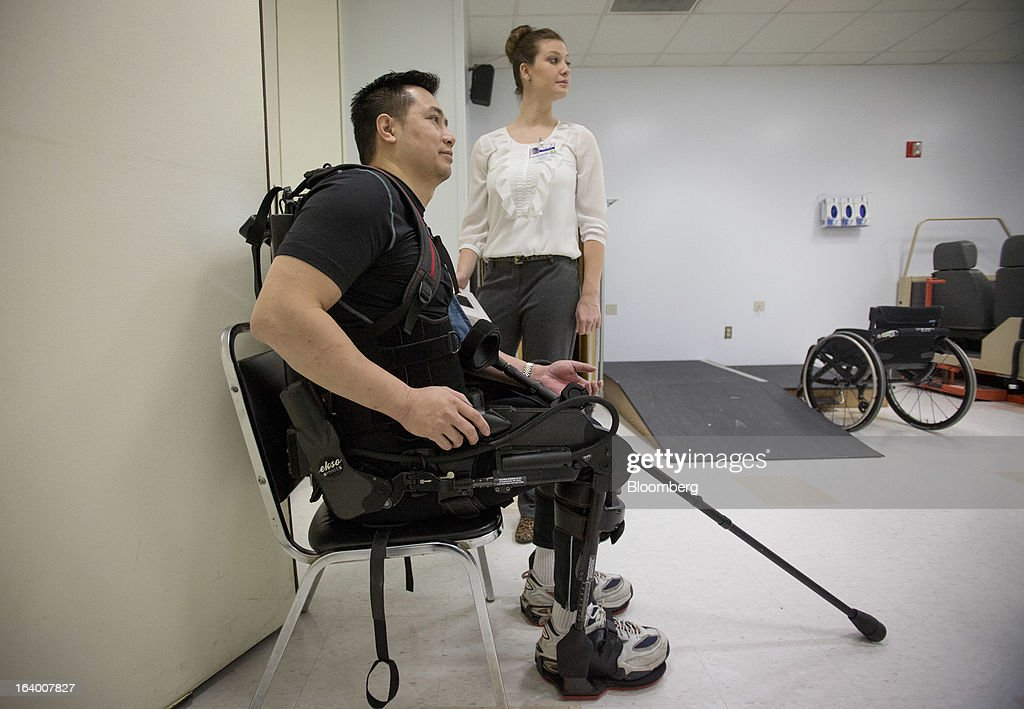 Robert Woo, 45, sits on a chair in an Ekso Bionics 'exoskeleton,' at Mount Sinai Medical Center in New York, U.S., on Thursday, March 14, 2013. Wearable machines that enhance human muscle power are poised to leave the realm of science fiction and help factory workers hoist heavier tools, lighten soldiers' loads and enable spinal patients to walk. Photographer: Scott Eells/Bloomberg via Getty Images