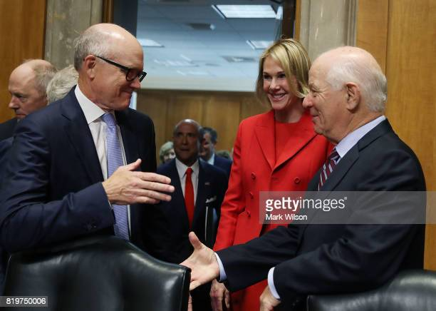 Robert Wood Johnson IV and Kelly Knight Craft talk with Sen Ben Cardin before their Senate Foreign Relations Committee confirmation hearing on...