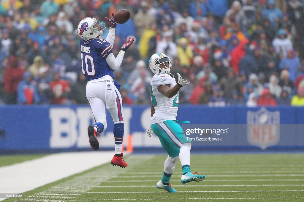 Robert Woods #10 of the Buffalo Bills catches a pass during NFL game action as <a gi-track='captionPersonalityLinkClicked' href=/galleries/search?phrase=Nolan+Carroll&family=editorial&specificpeople=5574471 ng-click='$event.stopPropagation()'>Nolan Carroll</a> #28 of the Miami Dolphins defends at Ralph Wilson Stadium on December 22, 2013 in Orchard Park, New York.