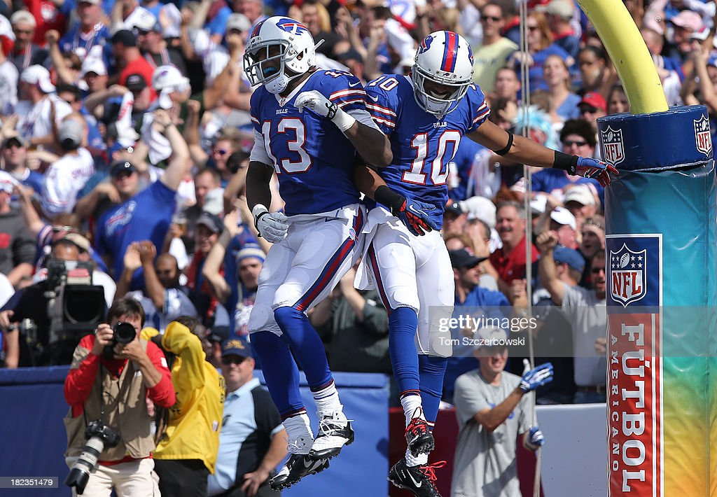 Robert Woods #10 of the Buffalo Bills celebrates his touchdown with Stevie Johnson #13 during NFL game action against the Baltimore Orioles at Ralph Wilson Stadium on September 29, 2013 in Orchard Park, New York.