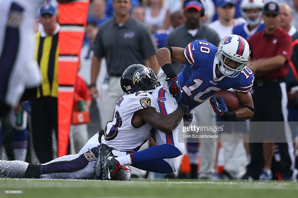 Robert Woods #10 of the Buffalo Bills is brought down by <a gi-track='captionPersonalityLinkClicked' href=/galleries/search?phrase=Chykie+Brown&family=editorial&specificpeople=4500802 ng-click='$event.stopPropagation()'>Chykie Brown</a> #23 of the Baltimore Orioles during NFL game action at Ralph Wilson Stadium on September 29, 2013 in Orchard Park, New York.