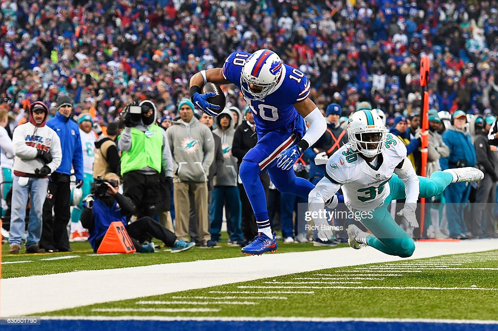Robert Woods #10 of the Buffalo Bills makes a catch in front of Bacarri Rambo #30 of the Miami Dolphins during the second half at New Era Stadium on December 24, 2016 in Orchard Park, New York.