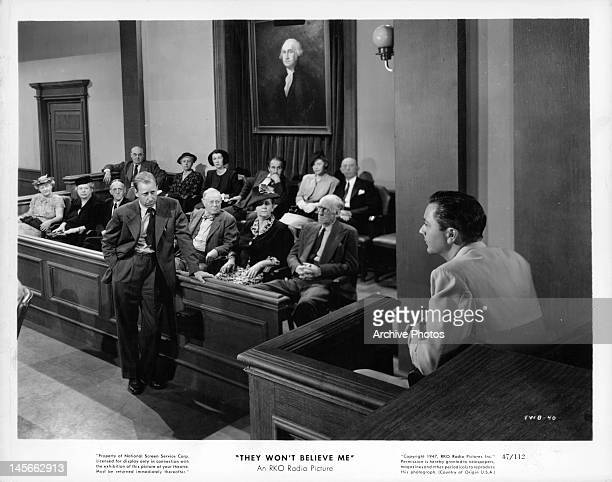 Robert Young testifying in court in a scene from the film 'They Won't Believe Me' 1947