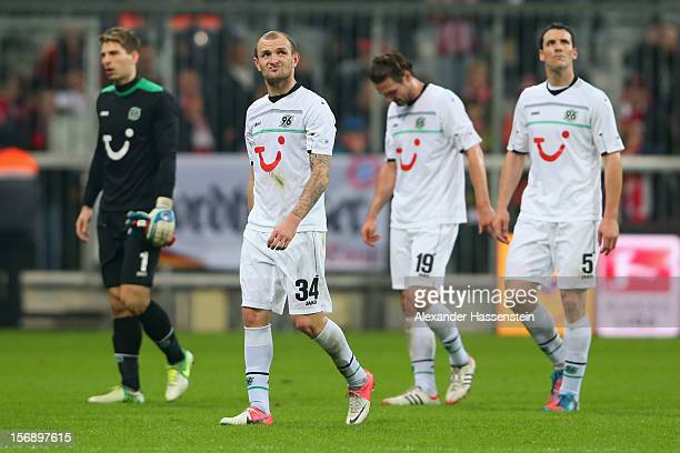 Robert Ziegler of Hannover looks dejected with his team mates Konstantin Rausch Christian Schulz and Mario Eggimann after the Bundesliga match...