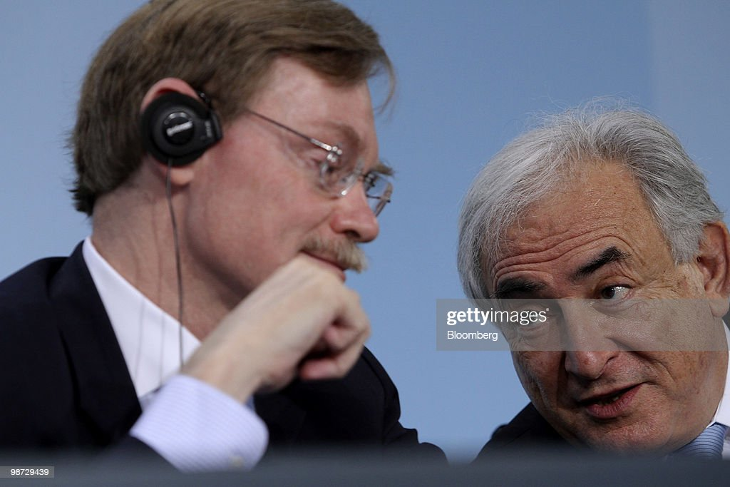 Robert, Zoellick, president of the World Bank, left, and Dominique Strauss-Kahn, managing director of the International Monetary Fund (IMF), participate in a news conference at the German federal chancellory in Berlin, Germany, on Wednesday, April 28, 2010. German Chancellor Angela Merkel and the IMF pledged to step up efforts to overcome the Greek fiscal crisis as Standard & Poor's downgraded Spain and investors sold bonds in Europe's most indebted nations. Photographer: Michele Tantussi/Bloomberg via Getty Images