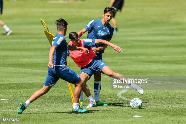 Robert Zulj of Hoffenheim Justin Hoogma of Hoffenheim and Marco Terrazzino of Hoffenheim battle for the ball during the Training Camp of TSG 1899...