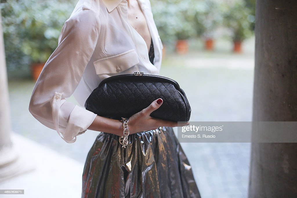 Roberta Altavilla wears Chanel bag and Ray Ban sunglasses on day 3 Rome Fashion Week Spring/Summer 2014, on January 26, 2014 in Rome, Italy.