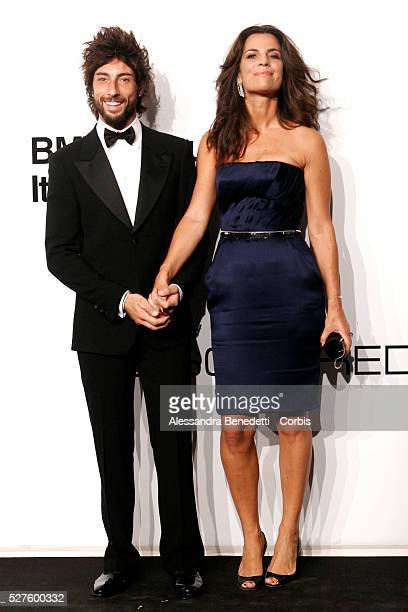 Roberta Armani and guest on the AmfAR Milano 2009 red carpet during the inaugural Milan Fashion Week event at La Permanente