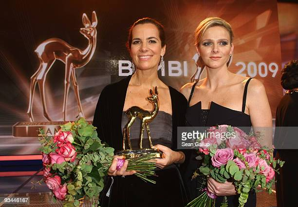 Roberta Armani poses with the 'Creativity' award for her father Giorgio Armani with swimmer Charlene Wittstock during the Bambi Awards 2009 show at...