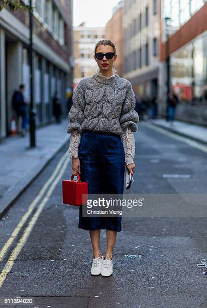 Roberta Benteler wearing a grey heavy knitwear sweater a Rejina blue skirt and Macgraw blouse seen outside Eudon Choi during London Fashion Week AW16...