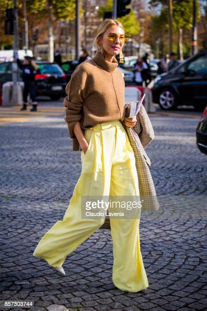 Roberta Benteler wearing brown turtleneck and wide leg pants is seen in the streets of Paris after the Chanel show during Paris Fashion Week...