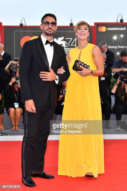 Roberta Giarrusso and Riccardo Di Pasquale walk the red carpet ahead of the 'The Shape Of Water' screening during the 74th Venice Film Festival at...