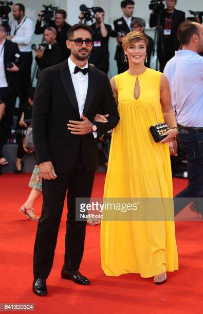 Roberta Giarrusso and Riccardo Di Pasquale walks the red carpet ahead of the 'The Shape Of Water' screening during the 74th Venice Film Festival in...