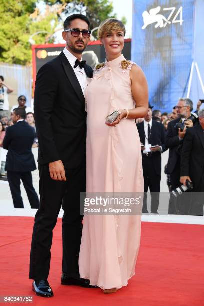 Roberta Giarrusso anhd Riccardo Pasquale walk the red carpet ahead of the 'Downsizing' screening and Opening Ceremony during the 74th Venice Film...