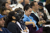 Roberta Griego and Babetta Juergens wear gas masks while attending a public hearing before the South Coast Air Quality Management District regarding...