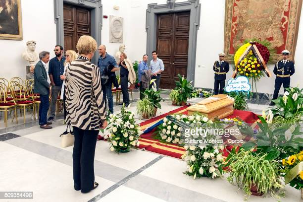 Roberta Pinotti Minister of Defense in front the coffin of Italian actor Paolo Villaggio lying in repose at Rome's city hall on July 5 2017 in Rome...