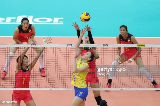 Roberta Silva Ratzke of Brazil in action against Xinyue Yuan #9 Changning Zhang #2 Ting Zhu and Yi Gao of China during the match between China and...