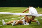 Roberta Vinci and Sara Errani of Italy celebrate winning their Ladies Doubles Final match against Timea Babos of Hungary and Kristina Mladenovic of...