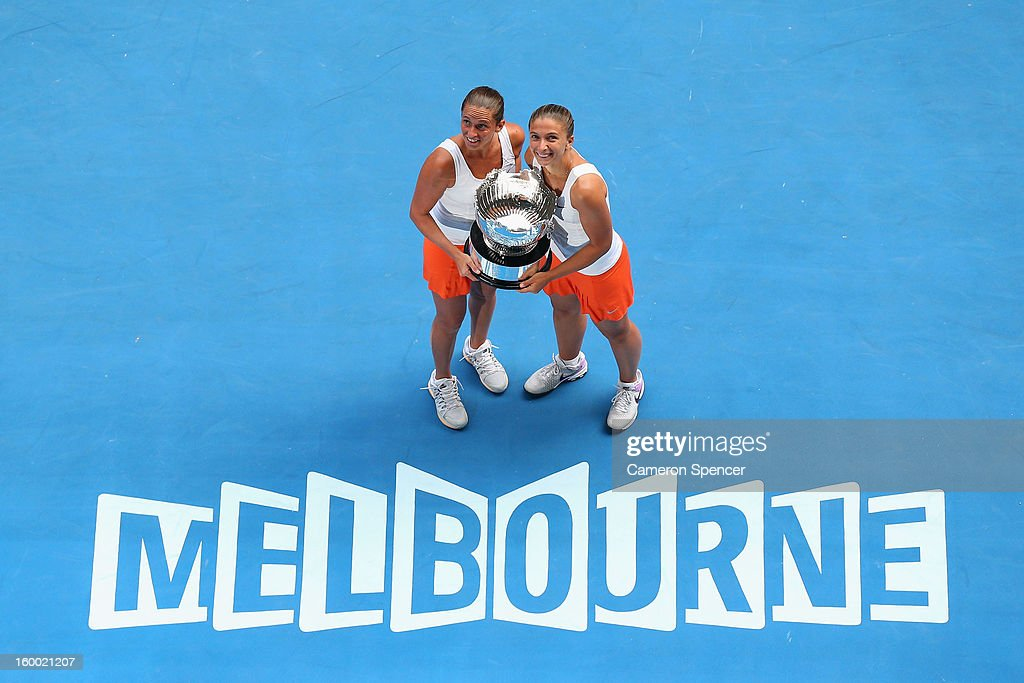 <a gi-track='captionPersonalityLinkClicked' href=/galleries/search?phrase=Roberta+Vinci&family=editorial&specificpeople=633555 ng-click='$event.stopPropagation()'>Roberta Vinci</a> and <a gi-track='captionPersonalityLinkClicked' href=/galleries/search?phrase=Sara+Errani&family=editorial&specificpeople=599213 ng-click='$event.stopPropagation()'>Sara Errani</a> of Italy pose with the championship trophy after winning their doubles final match against Ashleigh Barty and Casey Dellacqua of Australia during day twelve of the 2013 Australian Open at Melbourne Park on January 25, 2013 in Melbourne, Australia.