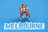 Roberta Vinci and Sara Errani of Italy pose with the championship trophy after winning their doubles final match against Ashleigh Barty and Casey...