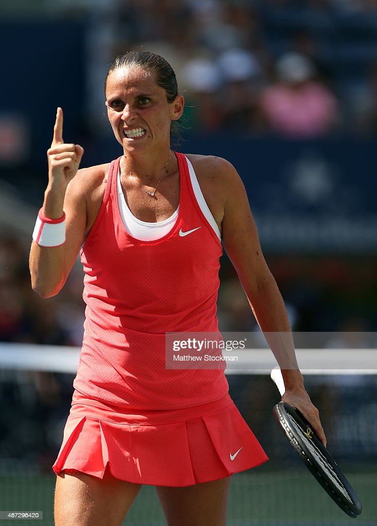 <a gi-track='captionPersonalityLinkClicked' href=/galleries/search?phrase=Roberta+Vinci&family=editorial&specificpeople=633555 ng-click='$event.stopPropagation()'>Roberta Vinci</a> of Italy celebrates a point against Kristina Mladenovic of France during their Women's Singles Quarterfinals Round match on Day Nine of the 2015 US Open at the USTA Billie Jean King National Tennis Center on September 8, 2015 in the Flushing neighborhood of the Queens borough of New York City.